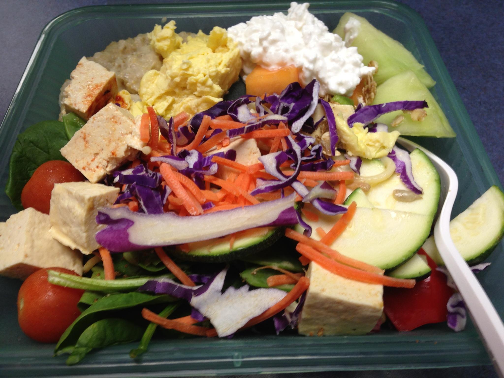 Salad, curry tofu, cottage cheese, scrambled eggs, and oatmeal